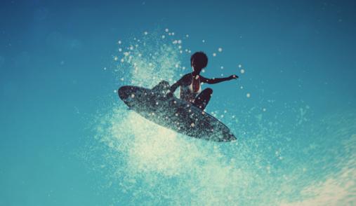 Serf World Series black woman jump on waves